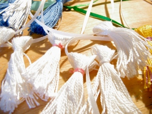 White tassels ready to bead